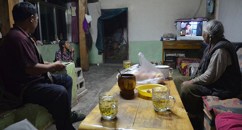 A Chinese family watching TV in their home
